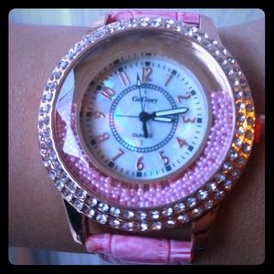 Beautiful pink snake skin and pearl watch!
